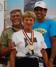 July 2008 Stan & Paula Brady on the Gold Podium with Bill.