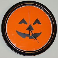 Jack-o-lantern clock with decor elements spooky expressions