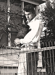 Clifford Atkins, Robin's daddy, with a black rabbit; picture taken prior to 1942