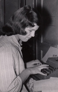 Robin Atkins writing a HS paper; 1959