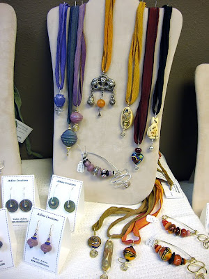 bead jewelry by Robin Atkins, featuring old silver pendants