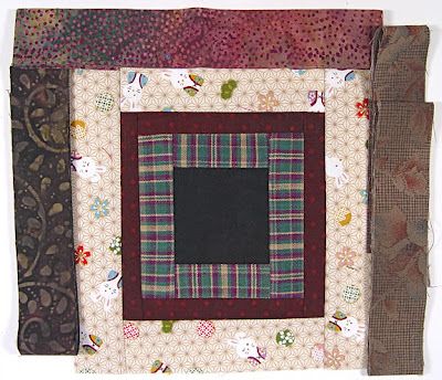 God's Eye Quilt by Robin Atkins, auditioning fabrics 22