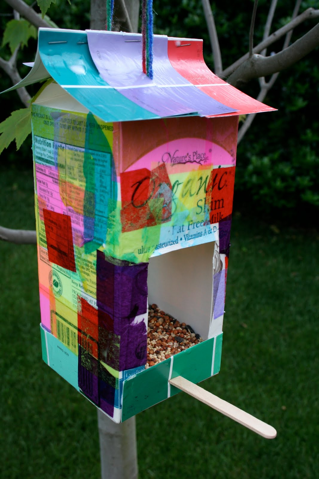 Pink and green mama summer nature crafts at rhythm of the for Plastic milk carton bird feeder