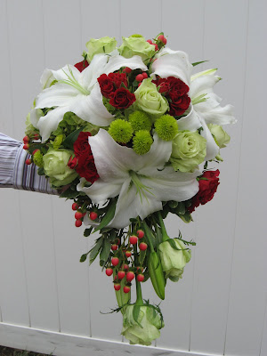 The bridal bouquet was a cascade style with green roses and button mums