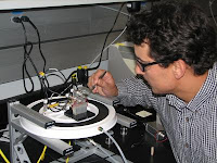 Caption: NIST chemist James Kushmerick adjusts test apparatus demonstrating a prototype silver nanoswitch. Credit: NIST. Usage Restrictions: None.