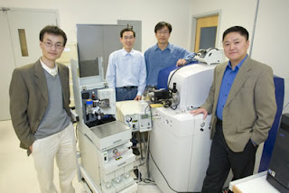 (From left) Peidong Yang, Mingquan Guo, Woong Kim and Daojing Wang have developed multinozzle nanoelectrospray emitter arrays that enable mass spectrometry to be fully integrated with microfluidic technology for proteomics research.