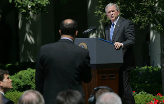 President George W. Bush listens to a question Thursday, May 24, 2007, during a press conference in the Rose Garden. The President said, 'Today, Congress will vote on legislation that provides our troops with the funds they need. It makes clear that our Iraqi partners must demonstrate progress on security and reconciliation. As a result, we removed the arbitrary timetables for withdrawal and the restrictions on our military commanders that some in Congress have supported.' White House photo by Chris Greenburg