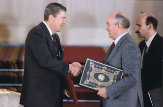 C47450-20, President Reagan and Soviet General Secretary Gorbachev shake hands after signing the INF Treaty ratification in the Grand Kremlin Palace during the Moscow Summit. 6/1/88. Courtesy Ronald Reagan Library