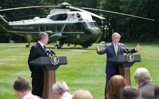 President George W. Bush and British Prime Minister Gordon Brown address the press Monday, July 30, 2007, at Camp David near Thurmont, Md. White House photo by Eric Draper.