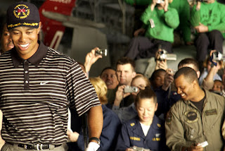 Crewmembers photograph professional golfer Tiger Woods as he walks through the hanger bay of the nuclear powered aircraft carrier USS George Washington (CVN 73). U.S. Navy photo by Photographer's Mate 1st Class Brien Aho. (RELEASED)