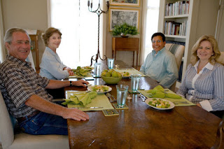 President George W. Bush and Mrs. Laura Bush sit with U.S. Attorney General Alberto Gonzales and his wife, Rebecca, during a visit Sunday, Aug. 26, 2007, at the Bush Ranch in Crawford, Texas. The Attorney General's resignation was announced Monday morning. In a statement, the President said, 'Al Gonzales is a man of integrity, decency and principle. And I have reluctantly accepted his resignation, with great appreciation for the service that he has provided for our country.' White House photo by Chris Greenberg