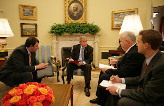 President George W. Bush goes over a draft of tonight's address to the nation with members of the White House speechwriting staff Thursday, Sept. 13, 2007, in the Oval Office. With him, from left, are: Marc Thiessen, Bill McGurn and Christopher Michel. White House photo by Eric Draper