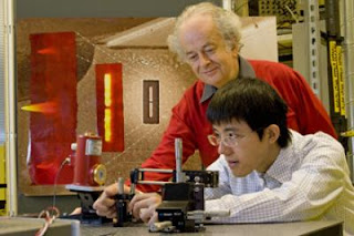 Caption: Federico Capasso and Nanfang Yu Demonstrate QC Laser Nanoantenna. Credit: Eliza Grinnell, Usage Restrictions: None.