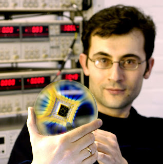 Dr Ponomarenko (who carried out this work) shows his research sample: graphene quantum dots on a chip.