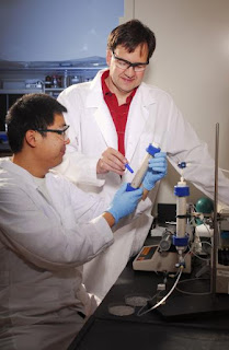 Researchers Kurt Pennell (standing) and Younggang Wang