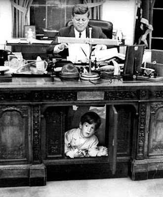 JFK Jr. under Resolute desk
