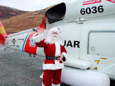 Larsen Bay, AK (Dec. 5)--Santa Claus waves goodbye to the crowd of children and adults in Larsen Bay. Santa and his staff traveled on board Coast Guard helicopters from Air Station Kodiak. USCG photo by PAC Marshalena Delaney