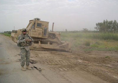 SFC Shaw overwatching the sanitation along RTE Christy west of FOB Kalsu, while the D-7 dozer (operated by SGT Hooper) clears debris and grass.