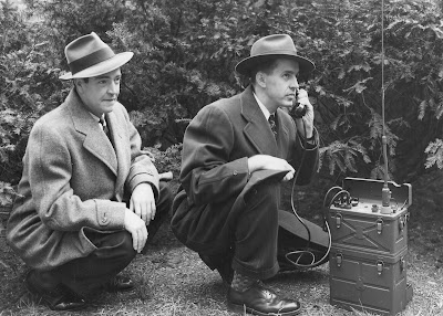 Special Agents communicating in the field, cir. 1940s