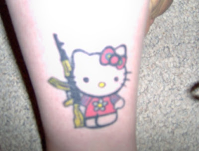 Isn't playing with guns, no no, leave the AK-47 for Hello Kitty!
