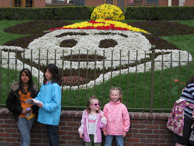 Mandi and Kimmie in front of the Mickey flowers