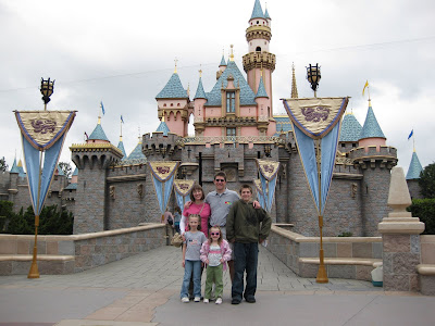 The family in front of the Magic Castle at the entrance of Fantasyland