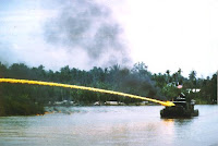 US riverboat firing napalm in Vietnam