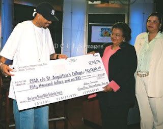 Iverson presents check to st. Augustine's College