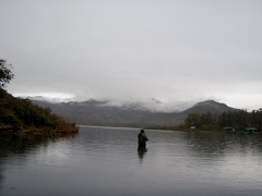 Fishing in the rain in Saltery Lake- Kodiak Island AK