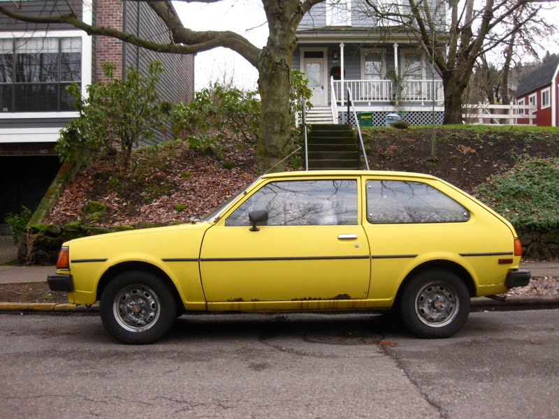 OLD PARKED CARS.: 1980 Mazda GLC, The \