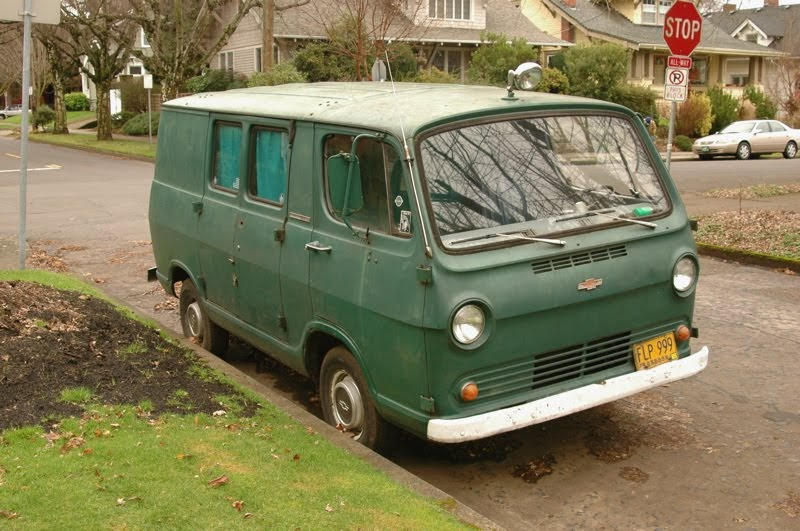 OLD PARKED CARS.: 1965 Chevy Van.