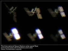 Sunlight glints from the space station's solar arrays on May 22, 2009