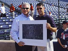 Astronaut Shane Kimbrough presents a picture of Atlanta taken from space to Braves General Manager Frank Wren