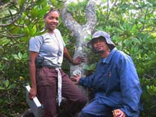 NASA researcher Lola Fatoyinbo (left), seen here in June 2005 on the site where she conducted some of her field measurements