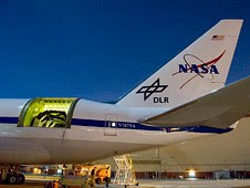 The SOFIA airborne observatory's 2.5-meter infrared telescope peers out from the SOFIA 747SP's rear fuselage during nighttime line operations testing