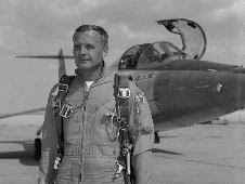 NASA research pilot Milt Thompson poses in front of an F-104 similar to the one from which he ejected on Dec. 20