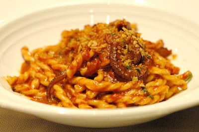 red wine braised octopus and bone marrow in fusilli