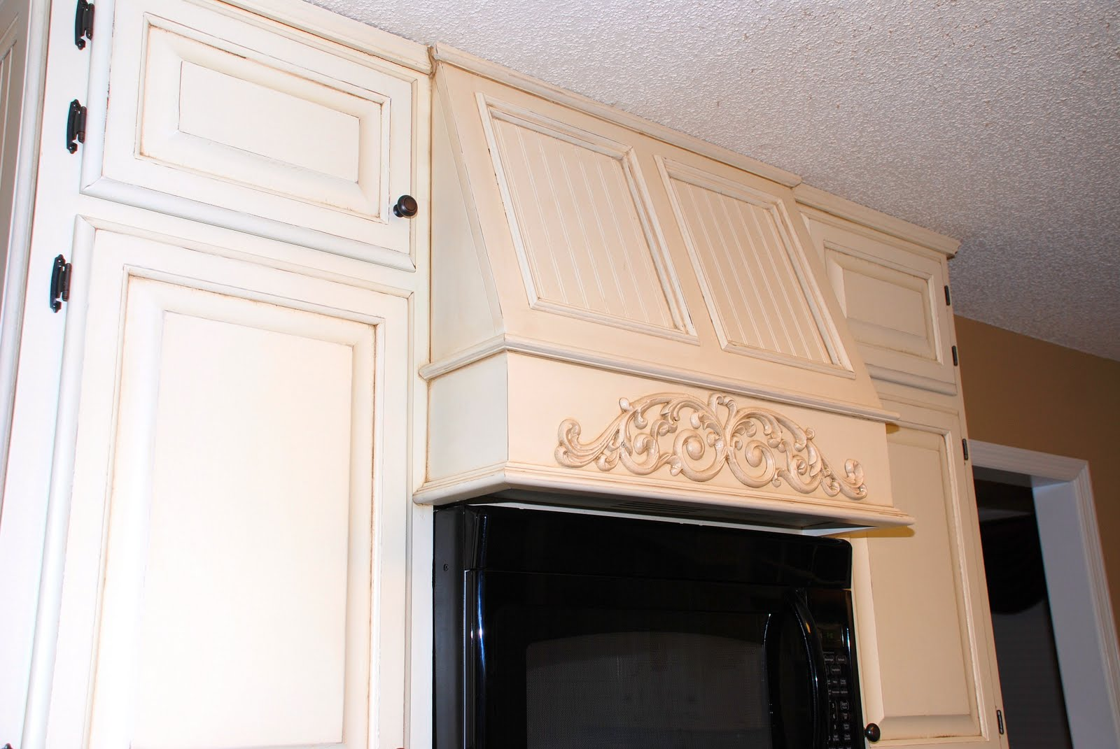 Remodelaholic from oak kitchen cabinets to painted - Painting over stained kitchen cabinets ...