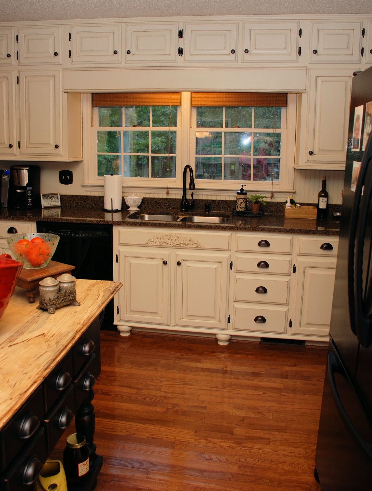 Antique White Kitchen Cabinets with Dark Countertops