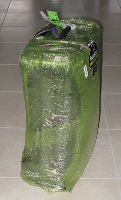 Shrink-wrapped luggage