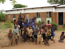Orphans posing outside the reading room classroom