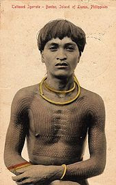 A young Bontok man from the Philippines with tattoos present on chest, and arms (circa 1908).