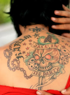 Extreme Skull tattoo on Back Body of Girl