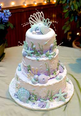wedding cakes pictures seashell wedding cake blue trim. Black Bedroom Furniture Sets. Home Design Ideas