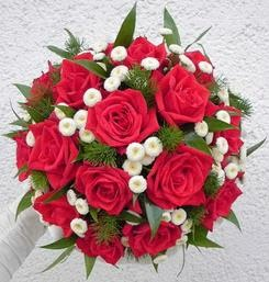 Red Roses With Small White Flowers And Some Greenery