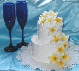 Delicate Two Tier Wedding Cake With Frangipanis