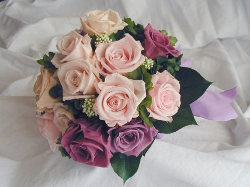 Bouquet bridal roses purple pink bouquet purple roses with a few pink roses white calla lilies and little blue flowers for accents mightylinksfo