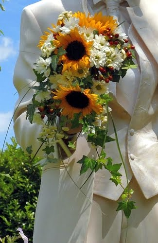 Sunflowers white flowers red berries and ivy leaves bridal bouquet