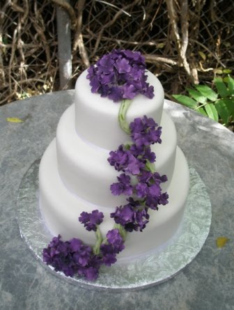 Square Three Tier Purple Wedding Cake With Cute White Flowers