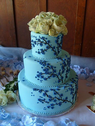 Four tier round wedding cake in tiffany blue with white cherry blossoms